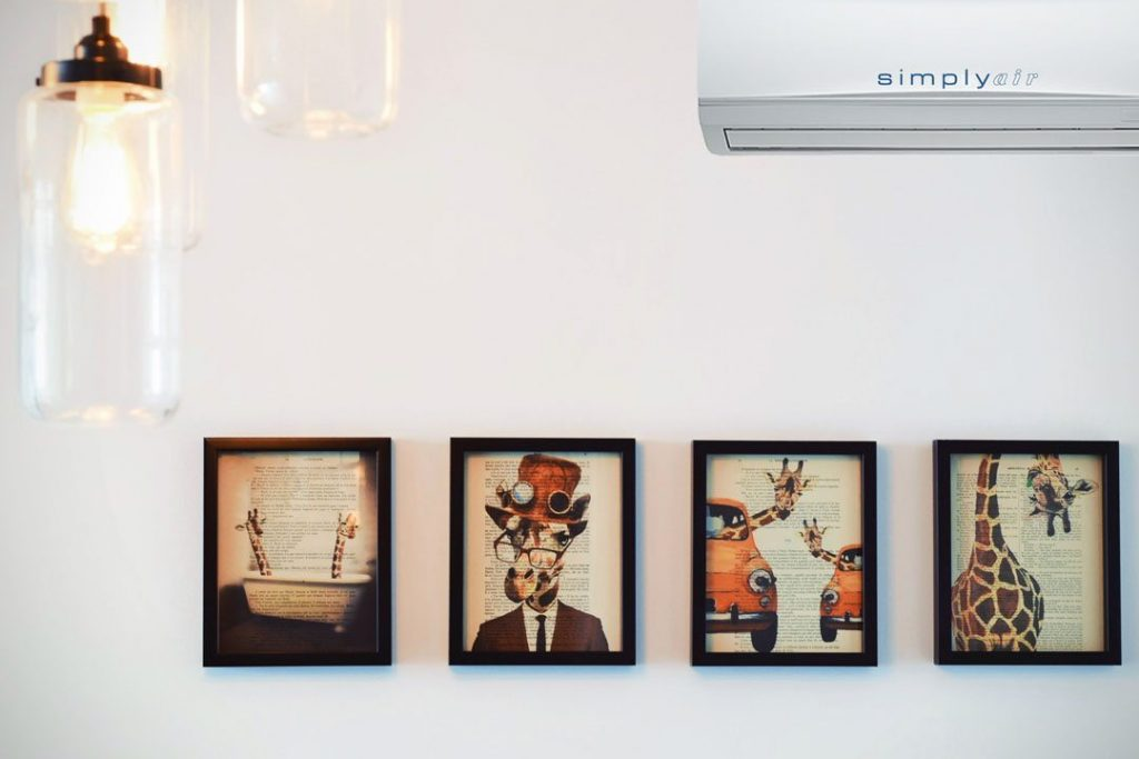 Simply Air Airconditioning system mounted on wall full of photo-frames