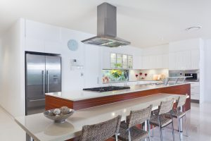 A modern kitchen with breakfast bar and stainless steel appliances