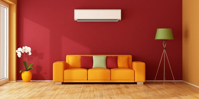 An air conditioning unit above a sofa in a colourful living room
